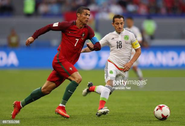 Cristiano Ronaldo of Portugal takes the ball past Andres Guardado of Mexico during the FIFA Confederations Cup Russia 2017 Group A match between...