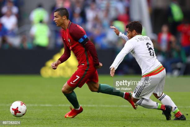 Cristiano Ronaldo of Portugal takes the ball past Jonathan Dos Santos of Mexico during the FIFA Confederations Cup Russia 2017 Group A match between...