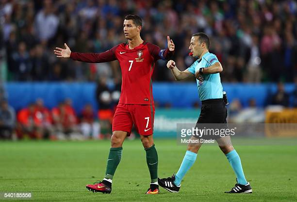 Cristiano Ronaldo of Portugal talks to referee Cuneyt Cakir after the 11 draw in the UEFA EURO 2016 Group F match between Portugal and Iceland at...