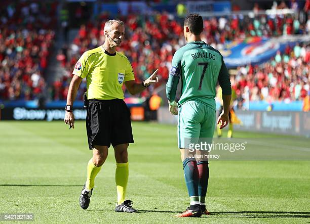 Cristiano Ronaldo of Portugal talks to referee Martin Atkinson after fouled during the UEFA EURO 2016 Group F match between Hungary and Portugal at...