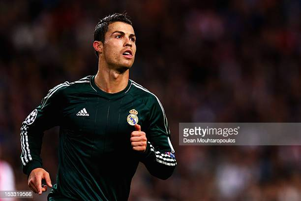 Cristiano Ronaldo of Real celebrates after he scores the fourth goal of the game during the UEFA Champions League Group D match between Ajax...