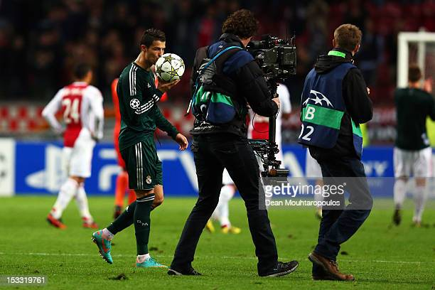 Cristiano Ronaldo of Real celebrates by kissing the ball after his hat trick in victory during the UEFA Champions League Group D match between Ajax...