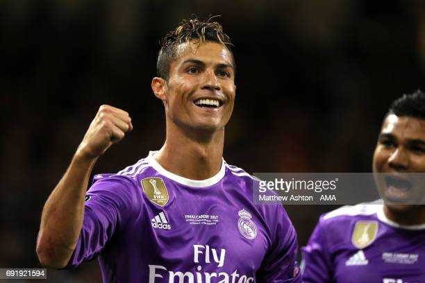 Cristiano Ronaldo of Real Madird celebrates scoring a goal to make the score 01 during the UEFA Champions League Final between Juventus and Real...