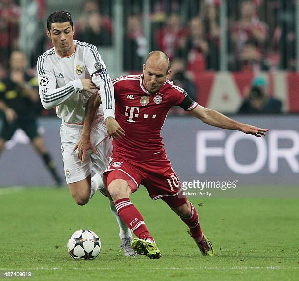 Cristiano Ronaldo of Real Madri challenges Arjen Robben of Bayern Muenchenl during the UEFA Champions League semifinal second leg match between FC...