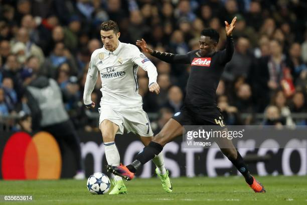 Cristiano Ronaldo of Real Madrid Amadou Diawara of SSC Napoliduring the UEFA Champions League round of 16 match between Real Madrid and SSC Napoli on...