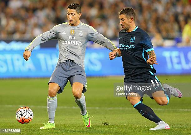 Cristiano Ronaldo of Real Madrid and Aleksandar Kolarov of Manchester City compete for the ball during the International Champions Cup match between...