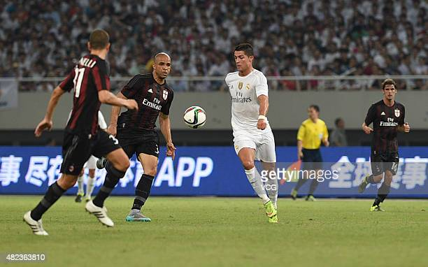 Cristiano Ronaldo of Real Madrid and Alex of AC Milan compete for the ball during the International Champions Cup football match between AC Milan and...