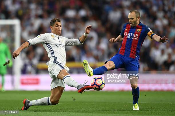 Cristiano Ronaldo of Real Madrid and Andres Iniesta of Barcelona battle for the ball during the La Liga match between Real Madrid CF and FC Barcelona...