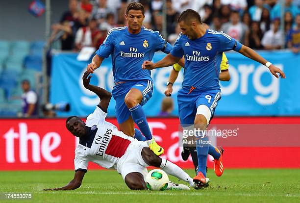 Cristiano Ronaldo of Real Madrid and Blaise Matuidi of PSG battle for the ball during the pre season friendly match between Real Madrid and Paris...