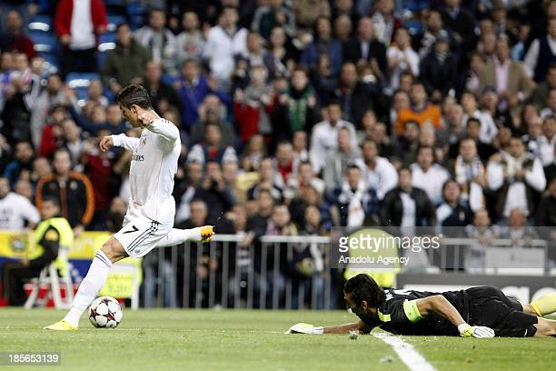 Cristiano Ronaldo of Real Madrid and Buffon of Juventus during the Champions League group B soccer match between Real Madrid and Juventus at Santiago...