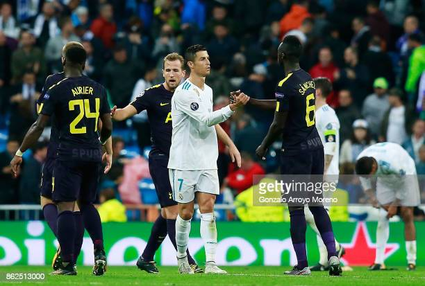 Cristiano Ronaldo of Real Madrid and Davinson Sanchez of Tottenham Hotspur shake hands after the UEFA Champions League group H match between Real...