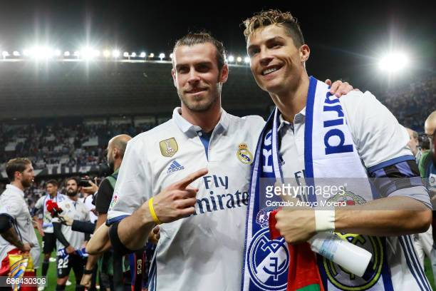 Cristiano Ronaldo of Real Madrid and Gareth Bale of Real Madrid celebrate after their team are crowned champions following the La Liga match between...