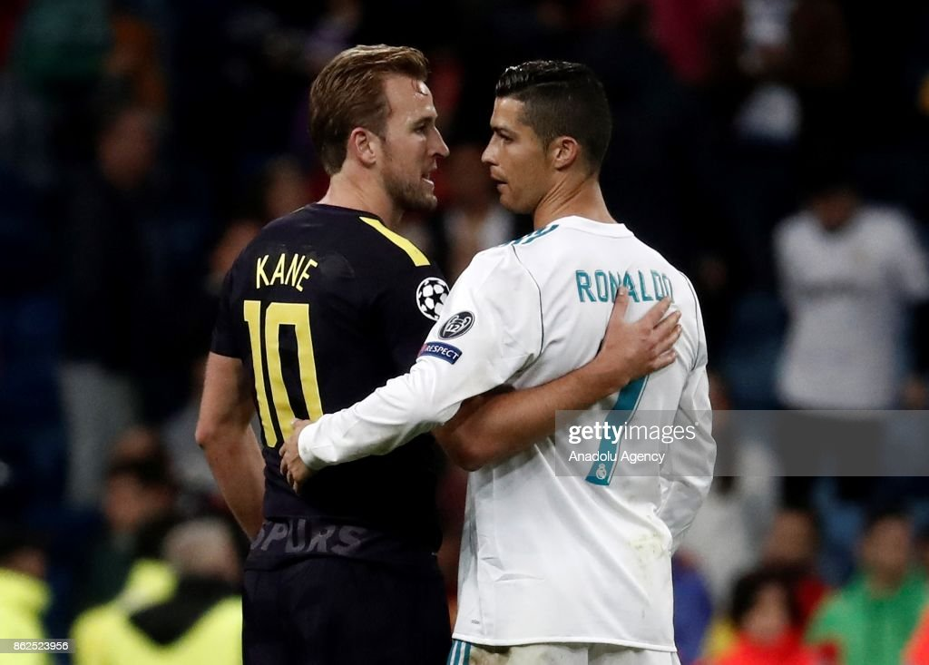 Cristiano Ronaldo (R) of Real Madrid and Harry Kane (L) of Tottenham congratulate each other after the UEFA Champions League Group H match between Real Madrid and Tottenham at Santiago Bernabeu Stadium in Madrid on October 17, 2017.