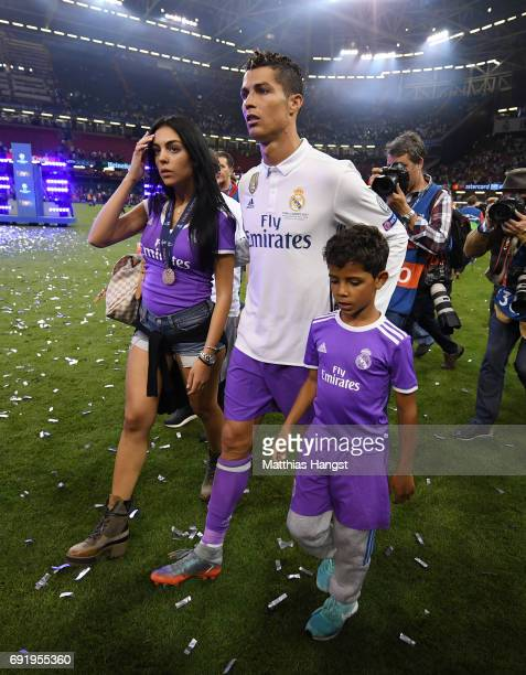 Cristiano Ronaldo of Real Madrid and his family are seen on the pitch after the UEFA Champions League Final between Juventus and Real Madrid at...