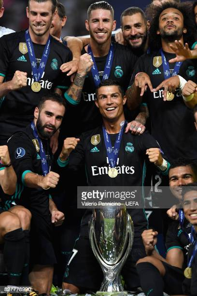 Cristiano Ronaldo of Real Madrid and his Real Madrid team mates celebrate with UEFA Super Cup trophy after the UEFA Super Cup final between Real...