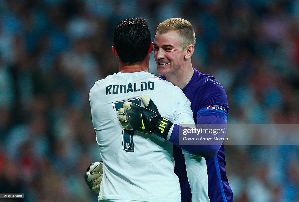 Cristiano Ronaldo of Real Madrid and Joe Hart of Manchester City share a joke during the UEFA Champions League semi final, second leg match between Real Madrid and Manchester City FC at Estadio Santiago Bernabeu on May 4, 2016 in Madrid, Spain.