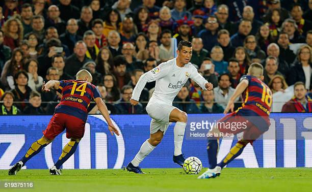 Cristiano Ronaldo of Real Madrid and Jordi Alba of Barcelona fc compete for the ball during the La Liga match between FC Barcelona and Real Madrid CF...