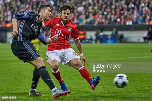 Cristiano Ronaldo of Real Madrid and Juan Bernat of Munich battle for the ball during the UEFA Champions League Quarter Final first leg match between...