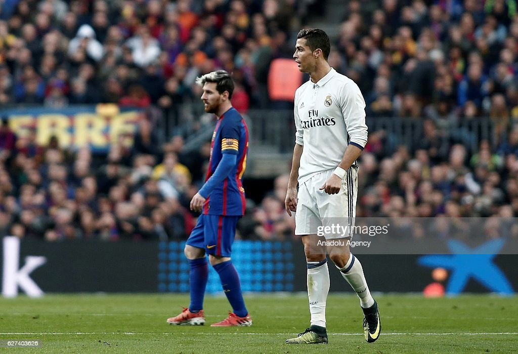 Cristiano Ronaldo (R) of Real Madrid and Lionel Messi (L) of Barcelona are seen during the La Liga football match between FC Barcelona and Real Madrid CF at Camp Nou Stadium in Barcelona, Spain on December 03, 2016.