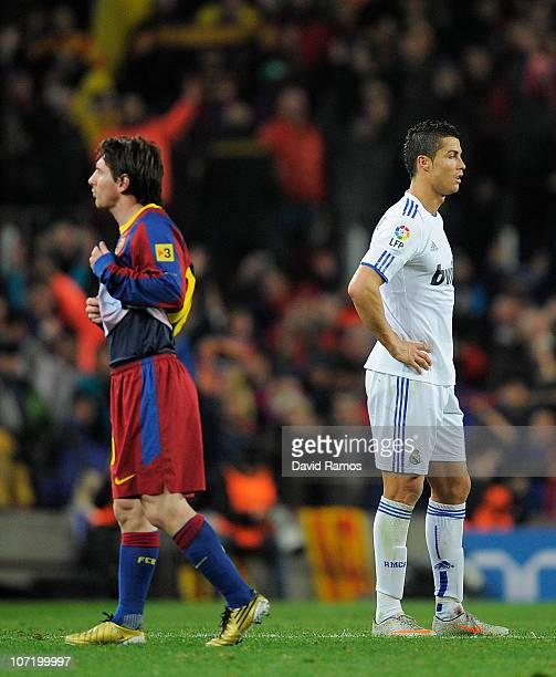 Cristiano Ronaldo of Real Madrid and Lionel Messi of FC Barcelona look on during the La Liga match between Barcelona and Real Madrid at the Camp Nou...