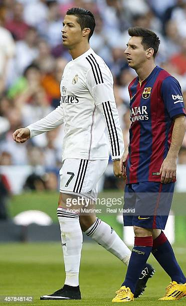 Cristiano Ronaldo of Real Madrid and Lionel Messi of FC Barcelona look on during the La Liga match between Real Madrid CF and FC Barcelona at Estadio...