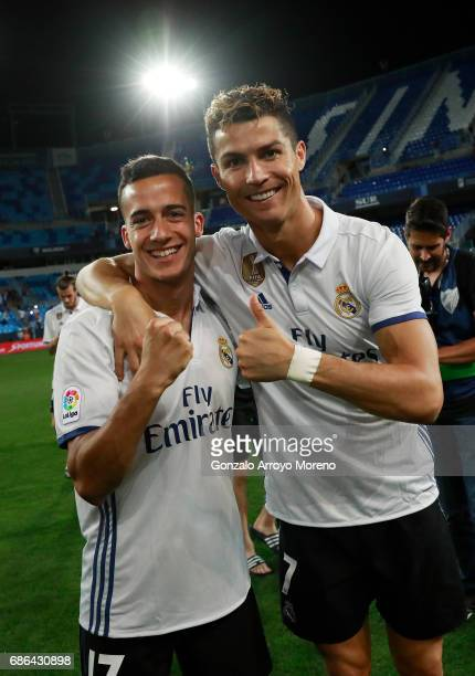 Cristiano Ronaldo of Real Madrid and Lucas Vazquez of Real Madrid celebrate being crowned champions following the La Liga match between Malaga and...