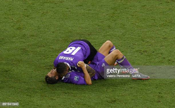 Cristiano Ronaldo of Real Madrid and Mariano of Real Madrid celebrate victory after the UEFA Champions League Final between Juventus and Real Madrid...