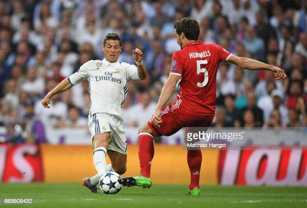 Cristiano Ronaldo of Real Madrid and Mats Hummels of Bayern Muenchen battle for possession during the UEFA Champions League Quarter Final second leg...