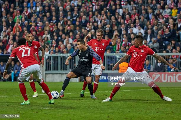 Cristiano Ronaldo of Real Madrid and Philipp Lahm of Munich and Jerome Boateng of Munich battle for the ball during the UEFA Champions League Quarter...