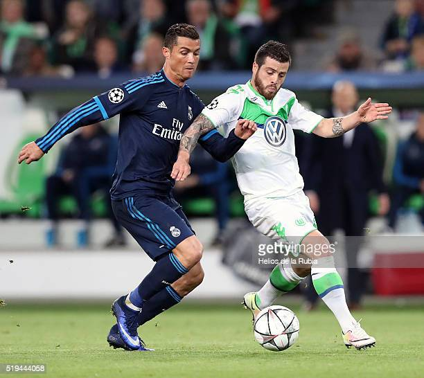 Cristiano Ronaldo of Real Madrid and Ricardo Rodríguez of Wolfsburg compete fort the ball during UEFA Champions League Quarter Final First Leg match...