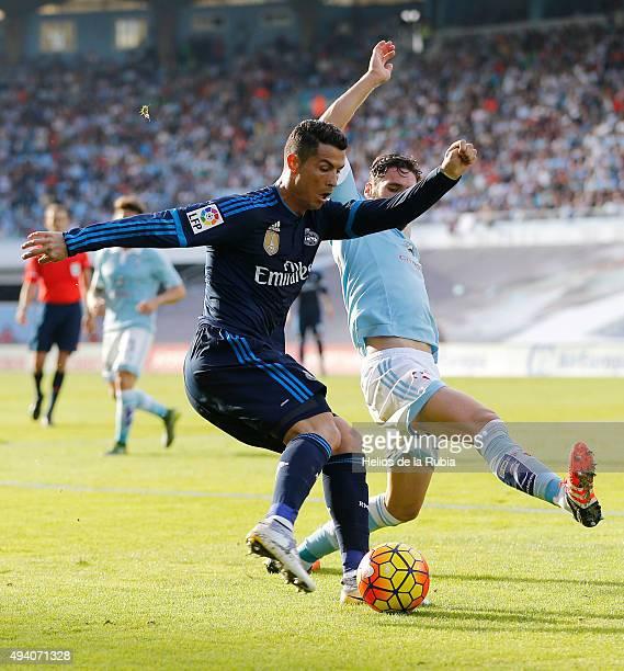 Cristiano Ronaldo of Real Madrid and Sergio Álvarez of Celta de Vigo compete for the ball during the La Liga match between Celta de Vigo and Real...