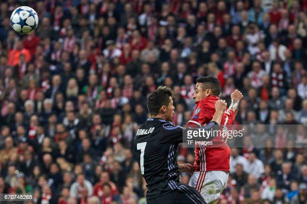 Cristiano Ronaldo of Real Madrid and Thiago of Munich battle for the ball during the UEFA Champions League Quarter Final first leg match between FC...