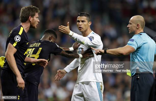 Cristiano Ronaldo of Real Madrid argues with Jan Vertonghen of Tottenham Hotspur during the UEFA Champions League group H match between Real Madrid...