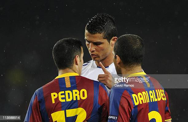 Cristiano Ronaldo of Real Madrid argues with Pedro Rodriguez and Dani Alves of FC Barcelona during the UEFA Champions League Semi Final second leg...