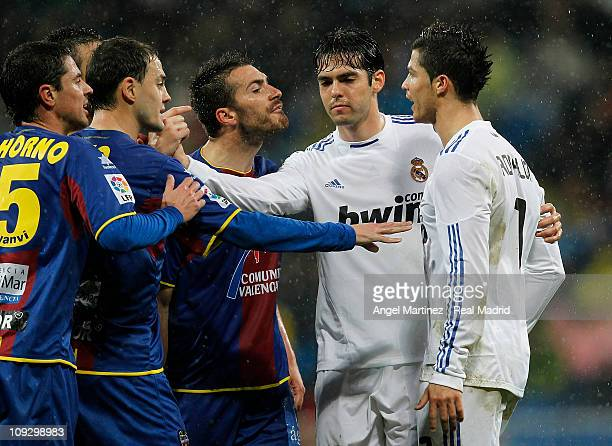 Cristiano Ronaldo of Real Madrid argues with Xavier Torres of Levante during the La Liga match between Real Madrid and Levante at Estadio Santiago...