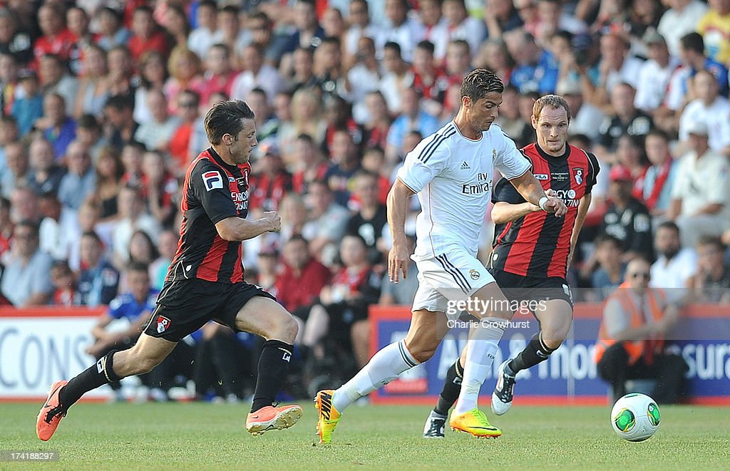 <a gi-track='captionPersonalityLinkClicked' href=/galleries/search?phrase=Cristiano+Ronaldo&family=editorial&specificpeople=162689 ng-click='$event.stopPropagation()'>Cristiano Ronaldo</a> of Real Madrid attacks during the pre season friendly match between Bournemouth and Real Madrid at Goldsands Stadium on July 21, 2013 in Bournemouth, England,