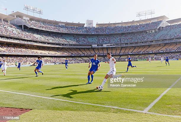 Cristiano Ronaldo of Real Madrid attacks the goal against defender Philip Jagielka of Everton during the fist half of the 2013 Guinness International...