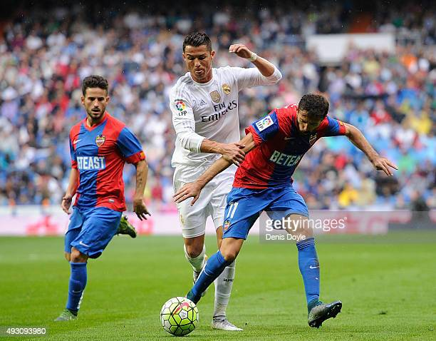 Cristiano Ronaldo of Real Madrid battles for the ball against Jose Luis Morales of Levante during the La Liga matce ball against h between Real...