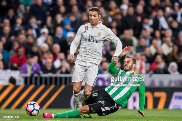 Cristiano Ronaldo of Real Madrid battles for the ball with German Pezzella of Real Betis during their La Liga match between Real Madrid and Real...