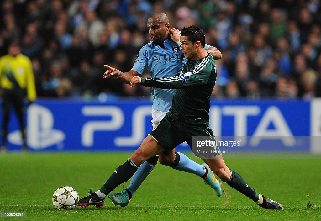 <a gi-track='captionPersonalityLinkClicked' href=/galleries/search?phrase=Cristiano+Ronaldo+-+Soccer+Player&family=editorial&specificpeople=162689 ng-click='$event.stopPropagation()'>Cristiano Ronaldo</a> of Real Madrid battles for the ball with Maicon of Manchester City during the UEFA Champions League Group D match between Manchester City FC and Real Madrid CF at the Etihad Stadium on November 21, 2012 in Manchester, England.