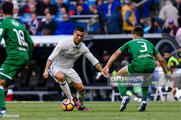 Cristiano Ronaldo of Real Madrid battles for the ball with Unai Bustinza of Deportivo Leganes during their La Liga match between Real Madrid and...
