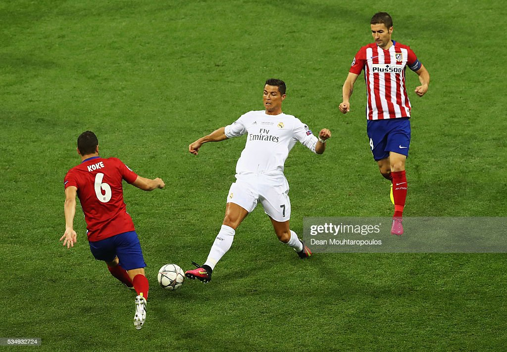 <a gi-track='captionPersonalityLinkClicked' href=/galleries/search?phrase=Cristiano+Ronaldo+-+Soccer+Player&family=editorial&specificpeople=162689 ng-click='$event.stopPropagation()'>Cristiano Ronaldo</a> of Real Madrid battles for the ball with with <a gi-track='captionPersonalityLinkClicked' href=/galleries/search?phrase=Koke+-+Midfielder+born+1992&family=editorial&specificpeople=11132098 ng-click='$event.stopPropagation()'>Koke</a> of Atletico Madrid during the UEFA Champions League Final match between Real Madrid and Club Atletico de Madrid at Stadio Giuseppe Meazza on May 28, 2016 in Milan, Italy.