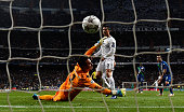 Cristiano Ronaldo of Real Madrid beats goalkeeper Diego Benaglio of VfL Wolfsburg to score their first goal during the UEFA Champions League quarter...