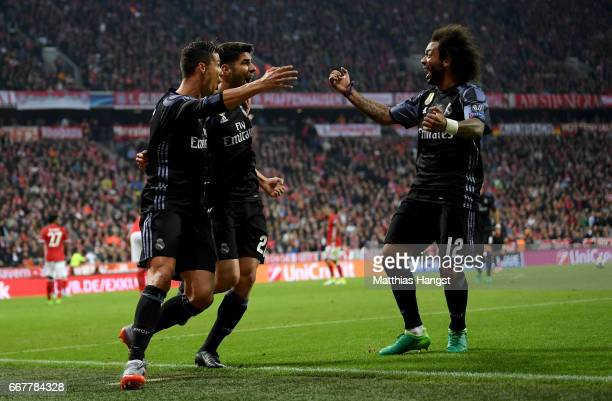 Cristiano Ronaldo of Real Madrid celebrate with team mate Marco Asensio and Marcelo after he scores his team's 2nd goal during the UEFA Champions...