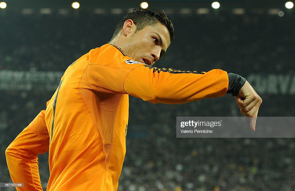 <a gi-track='captionPersonalityLinkClicked' href=/galleries/search?phrase=Cristiano+Ronaldo+-+Soccer+Player&family=editorial&specificpeople=162689 ng-click='$event.stopPropagation()'>Cristiano Ronaldo</a> of Real Madrid celebrates a goal during the UEFA Champions League Group B match between Juventus and Real Madrid at Juventus Arena on November 5, 2013 in Turin, Italy.