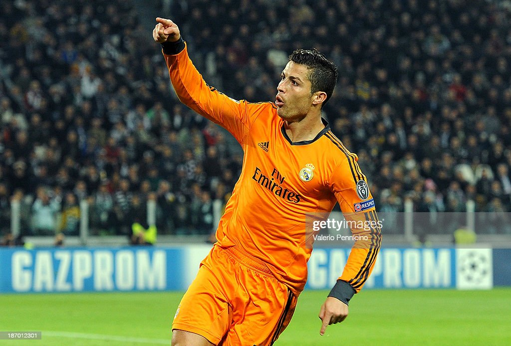 <a gi-track='captionPersonalityLinkClicked' href=/galleries/search?phrase=Cristiano+Ronaldo+-+Soccer+Player&family=editorial&specificpeople=162689 ng-click='$event.stopPropagation()'>Cristiano Ronaldo</a> of Real Madrid celebrates after scoring a goal during the UEFA Champions League Group B match between Juventus and Real Madrid at Juventus Arena on November 5, 2013 in Turin, Italy.