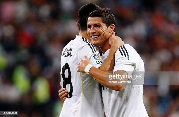 Cristiano Ronaldo of Real Madrid celebrates after scoring a goal with team mate Ezequiel Garay during the La Liga match between Real Madrid and Xerez...