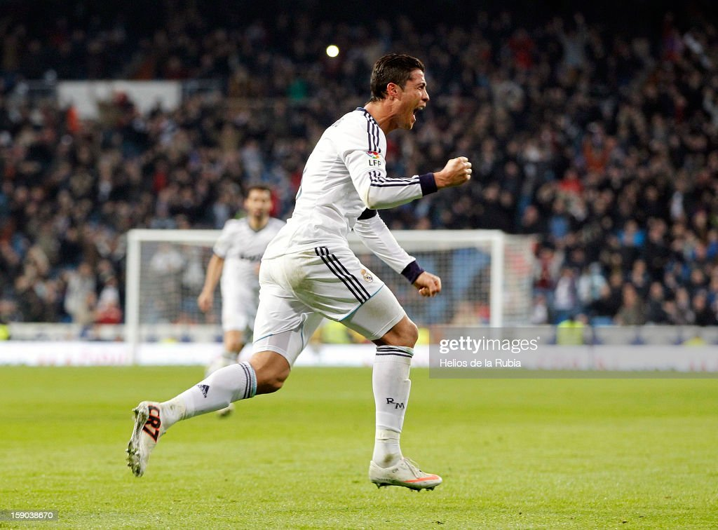 <a gi-track='captionPersonalityLinkClicked' href=/galleries/search?phrase=Cristiano+Ronaldo+-+Calciatore&family=editorial&specificpeople=162689 ng-click='$event.stopPropagation()'>Cristiano Ronaldo</a> of Real Madrid celebrates after scoring during the La Liga match between Real Madrid and Real Sociedad at Estadio Santiago Bernabeu on January 6, 2013 in Madrid, Spain.