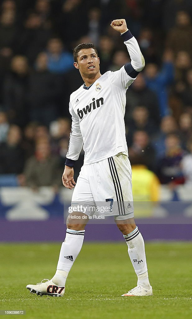 <a gi-track='captionPersonalityLinkClicked' href=/galleries/search?phrase=Cristiano+Ronaldo+-+Soccer+Player&family=editorial&specificpeople=162689 ng-click='$event.stopPropagation()'>Cristiano Ronaldo</a> of Real Madrid celebrates after scoring during the La Liga match between Real Madrid and Real Sociedad at Estadio Santiago Bernabeu on January 6, 2013 in Madrid, Spain.