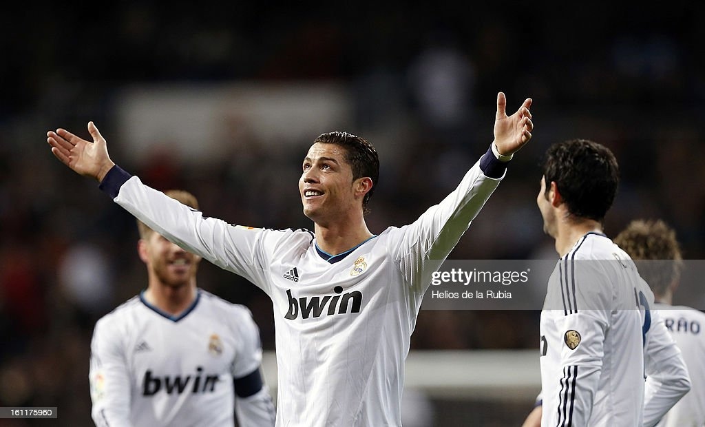 <a gi-track='captionPersonalityLinkClicked' href=/galleries/search?phrase=Cristiano+Ronaldo+-+Soccer+Player&family=editorial&specificpeople=162689 ng-click='$event.stopPropagation()'>Cristiano Ronaldo</a> of Real Madrid celebrates after scoring during the La Liga match between Real Madrid CF and Sevilla FC at Estadio Santiago Bernabeu on February 9, 2013 in Madrid, Spain.